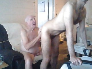 A young man pleasing an elderly man